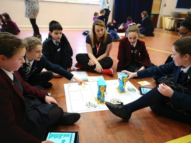 Tanya teaches a class about technology